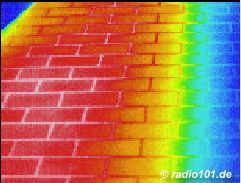 Thermographic picture - infrared photograph: hot tiles on a balcony in the summertime, partially shadowed